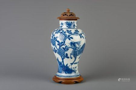 A Chinese blue and white 'kylin' vase with wooden cover and stand, 19th C.