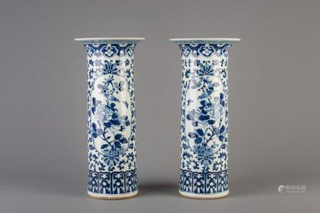 A pair of Chinese blue and white cylindrical vases with floral design and animals, 19th C.