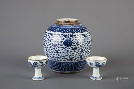 A Chinese blue and white ginger jar and two stem cups with floral design, Qianlong