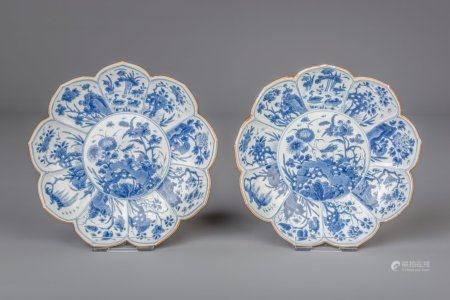 A pair of Chinese blue and white lotus shaped plates with floral design, Kangxi