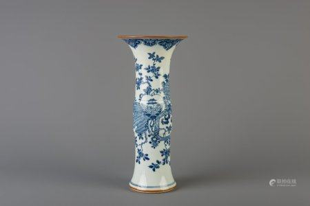 A Chinese blue and white gu beaker vase with floral design, Qianlong