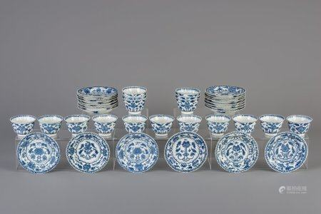 Seventeen Chinese blue and white cups and twenty-two saucers with floral design, Kangxi