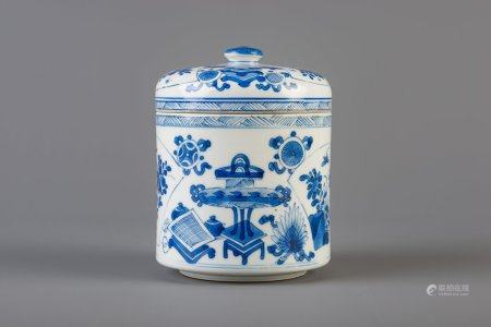 A Chinese blue and white round box and cover with antiquities and flowers, Kangxi