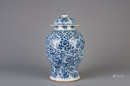 A Chinese blue and white vase and cover with phoenixes, Kangxi