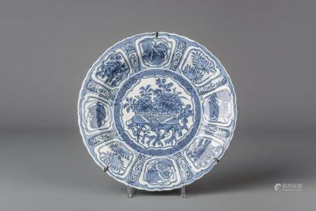 A Chinese blue and white kraak porcelain plate with flowers and antiquities, Wanli