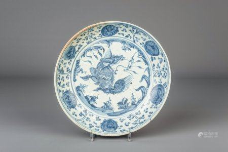 A Chinese blue and white charger with floral design and a lion, Ming, Hongzhi