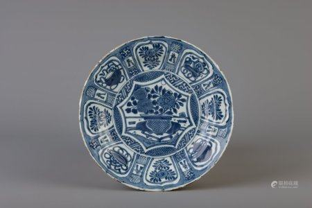 A Chinese blue and white plate with flowers and antiquities, Wanli