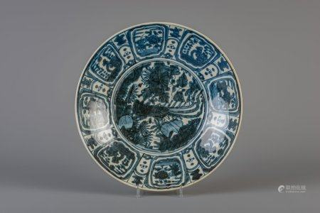 A large Chinese blue and white Swatow charger with a phoenix, Ming