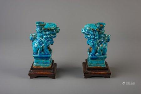 A pair of Chinese turquoise glazed models of Buddhist lions, Ming