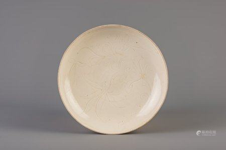 A Chinese carved white glazed dingyao dish, Ming or later