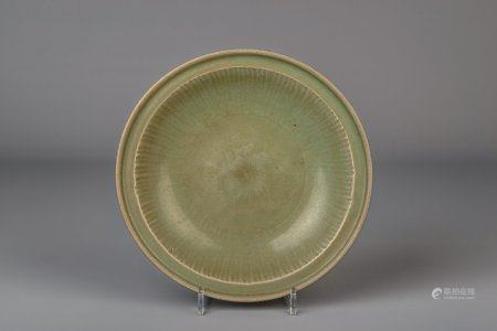 A Chinese Longquan celadon dish with floral underglaze design, Ming