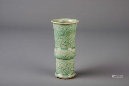 A Chinese Longquan celadon gu vase with underglaze design, Ming