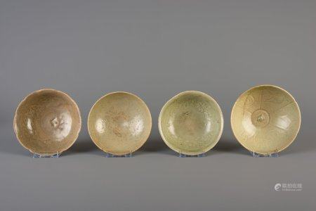 Four Chinese green glazed bowls with underglaze design, Song