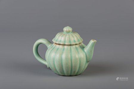 A Chinese chrysanthemum shaped celadon glazed stoneware teapot and cover, 18th/19th C.