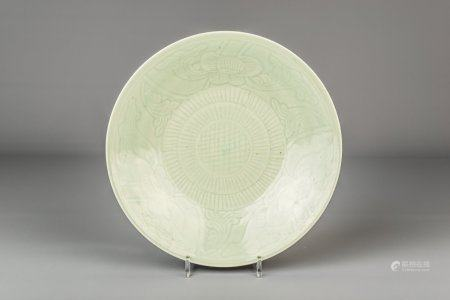 A Chinese celadon dish with incised floral design, 19th C.