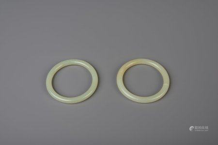Two Chinese celadon jade bangles, 19th/20th C.