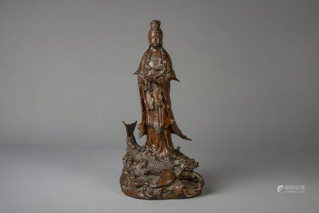A Japanese bronze group depicting Kannon on a carp, Meiji, 19th C.