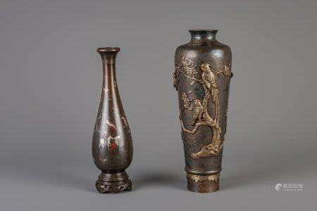 Two Japanese bronze vases, one relief decorated with various birds near blossoming branches and marked, one mixed metal vase, Meiji