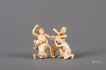 A Japanese carved ivory 'trouble in paradise' group, Meiji, 19th C.
