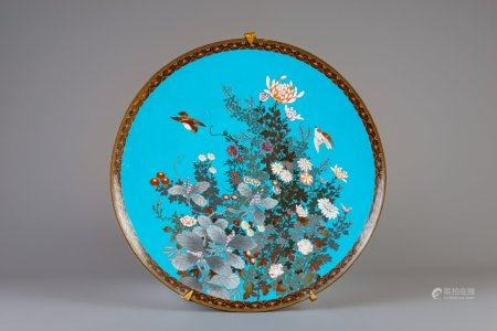 An impressive Japanese cloisonne charger with two birds enjoying various blossoming branches, Meiji, late 19th C.