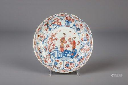 A Chinese Imari style plate with figures in a landscape, Kangxi/Yongzheng