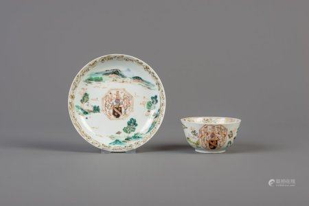 A Chinese famille rose armorial cup and saucer, Qianlong
