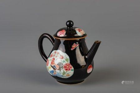 A Chinese famille rose black ground 'rooster' teapot and cover, Yongzheng