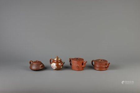 Three Chinese Yixing teapots and a famille rose 'capucin' teapot, Qianlong, 19th and 20th C.