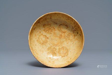 A Chinese pottery bowl with incised floral design, Tang