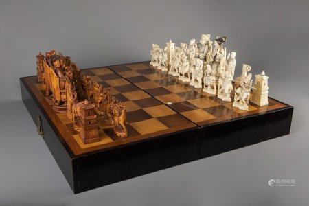A large Chinese carved ivory chess set with board, second quarter 20th C.