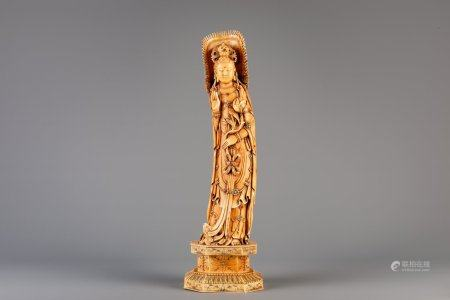 A tall Chinese carved ivory figure of Guanyin, 19th C.