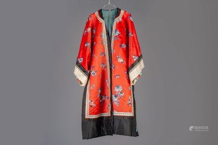 A Chinese red ground embroidered silk robe, 19th C.