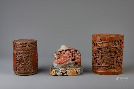 Two Chinese carved bamboo brush pots and a soapstone group with a laughing Buddha, 19th/20th C.