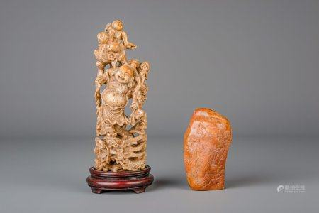 A Chinese landscape decorated Shoushan soapstone rock and a group with a laughing Buddha and boys, 19th/20th C.