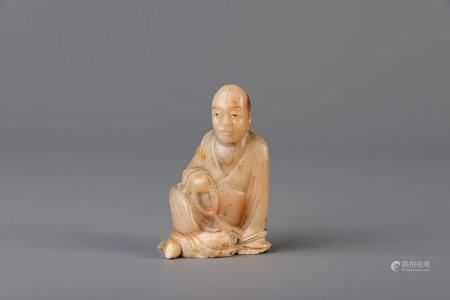 A Chinese soapstone figure of a sage, 19th C.