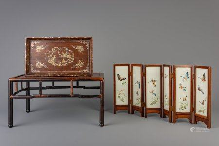 A collection of Chinese wooden scholar's objects consisting of a tray with mother-of-pearl inlay, a table screen and a small table, 20th C.
