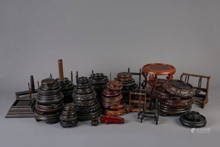 A collection of Chinese wooden stands and a collection plate holders, 19th/20th C.
