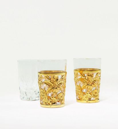 德力纯金镂雕花卉杯套二点、配水晶杯三点