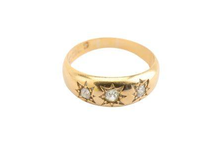 A diamond three-stone ring, 1914-5