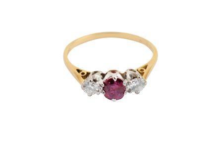 A ruby and diamond three-stone ring