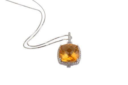 A citrine and diamond pendant necklace