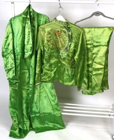 A pair of Chinese silk embroidered pyjamas and gown, decorated with a dragon on a lime green
