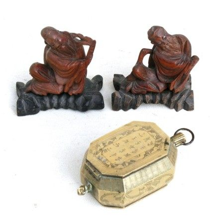 A Chinese bronze betel nut container of octagonal form, decorated with a figure on one side and