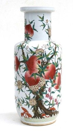A Chinese rouleau vase decorated with peaches and flowers, 45cms (17.5ins) high.
