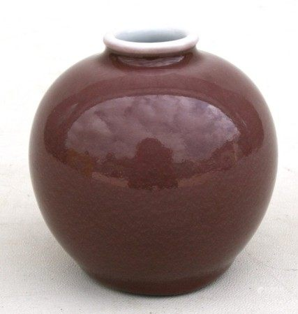 A Chinese monochrome dark pink glaze vase of globular form with six-character blue mark to