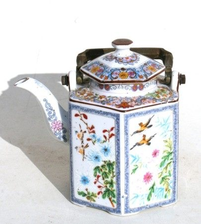 A Chinese famille rose teapot of hexagonal form decorated with birds and flowers, with bronze