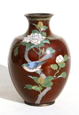 A Japanese cloisonne vase decorated with bird perched in flowering foliage, on a gold flecked