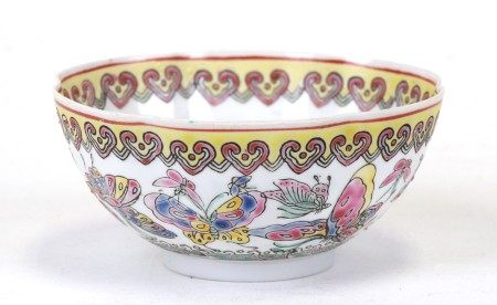 A Chinese famille rose eggshell bowl decorated with butterflies and flowers, four character red seal