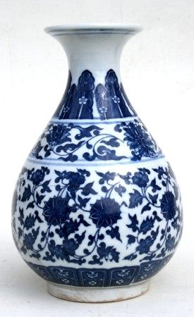 A Chinese blue & white vase decorated with foliate scrolls, six character seal mark to underside,