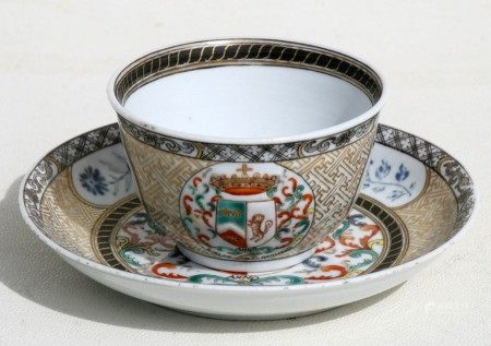 An 18th century Chinese Export tea bowl and saucer decorated with an Armorial crest dated 1783, 4.